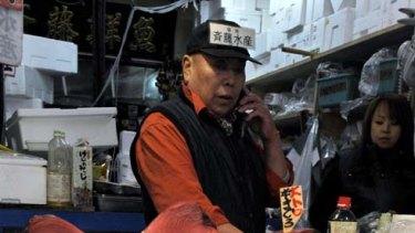 Abundant sashimi, for now … at Tokyo's Tsukiji fish market, traders cheered news of the defeat.