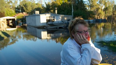 Nathalia resident Pat Butler takes a break after her house flooded.