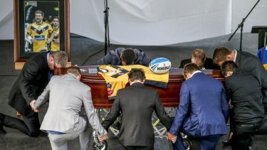 Close to 1000 mourners attended James Ackerman's funeral.