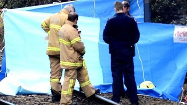 Police and fire crews examine the grisly scene.