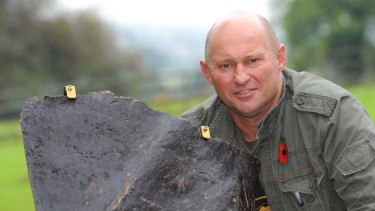 Former SAS soldier Nigel 'Spud' Ely with the offending piece of bronze.