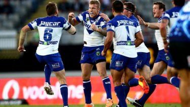 Trent Hodkinson of the Bulldogs celebrates his match-winning drop goal against the Warriors.