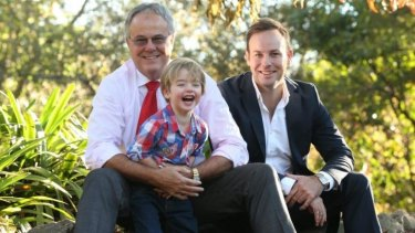 Dr Tim Hawkes with son Peter and grandson William in the grounds of King's School. Hawkes is the author of a new parenting manual, <i>Ten Conversations You Must Have With Your Son</i>.