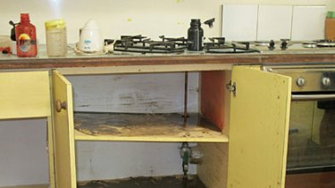 Mud was strewn through the kitchen of the Moore residence.
