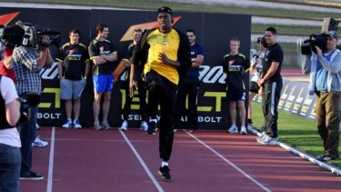 Master class ... Jamaican superstar Usain Bolt shows some of Australia's fastest footballers how it is done yesterday.