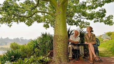 Garden of plenty: Attila Kapitany and his wife, Michelle, sit in their impressive garden.