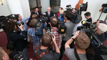 Attorney-General Senator George Brandis addresses the media in the press gallery on Thursday.