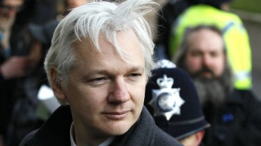 Holed up ... public opinion is split on whether the Australian government is doing enough to help Julian Assange.