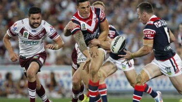 Sonny Bill Williams offloads in the NRL grand final.
