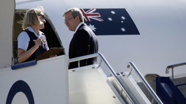 Preparing to take off . . . Kevin Rudd boarding his plane for Jakarta yesterday.