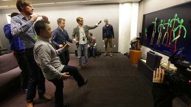 Journalists try out the new Kinect controller at the Xbox One launch.