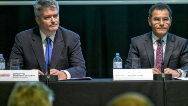 Finance minister Mathias Cormann and Medibank managing director George Savvides at a press conference last month.