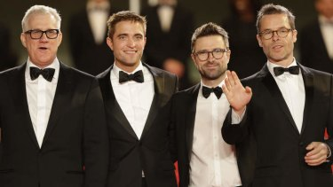 Producer David Linde, Robert Pattinson, director David Michod, and Guy Pearce arrive for the screening of <i>The Rover</i> in Cannes on May 18, 2014.