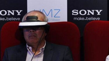 Reporters try Sony's head mounted display.