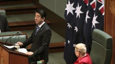 Japanese Prime Minister Shinzo Abe addresses the House of Representatives as Speaker Bronwyn Bishop looks on.