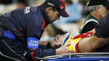 Daniel Bell after being knocked out in a Melbourne v Collingwood game in 2007.