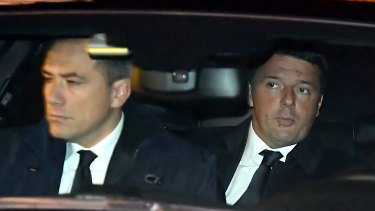 Italian Premier Matteo Renzi, right, arrives at the presidential palace to tender his resignation.