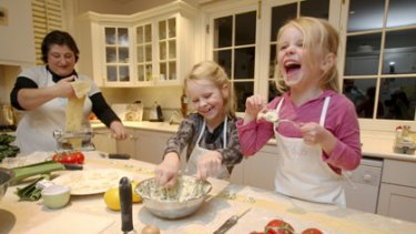 Play's the thing ... learning to make ravioli gives Ruby and Holly Lewis plenty to laugh about.