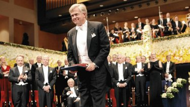 Recognition … Schmidt accepts the 2011 physics prize at the Nobel award ceremony in Stockholm.
