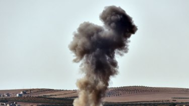 Smoke rises from an air strike on the outskirts of Kobane. Islamic State has taken a third of the town.
