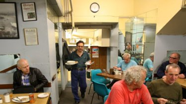 Food and friendship ... Paul Varvaressos serves customers at the New York Restaurant in Kellett Street, Kings Cross.