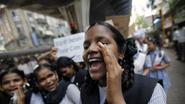 A schoolgirl shouts slogans at a campaign rally calling for calm regarding the disputed site in Ayodhya.