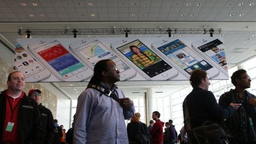 Attendees gather at the Apple Worldwide Developers Conference, where the company unveiled iOS 8 and the new mac operating system Yosemite.