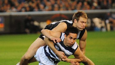 Ben Reid tackles Matthew Stokes during the first preliminary final in 2010.