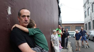 Too many venues ... Anthony Schofield with his son and other concerned locals.