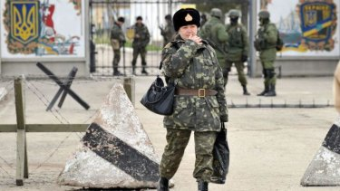 A Ukrainian army sergeant walks outside the Ukrainian military base blocked by Russian forces in Perevalnoye, near Simferopol.