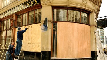 Safety measures: A tailor's in central London is boarded up in readiness for protests during the G20 summit.