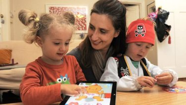 """Big Baby"" App designer, Gabrielle Banks, at her Barton home with her two children Max Horth, 4 and Nelly Horth, 3, playing the game on their iPad."