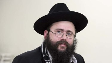 Rabbi Yosef Feldman ... email saying sex abuse allegations should be handled within the Jewish community was not his ''official position''.