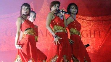 Members of the Me N Ma Girls band perform in Rangoon.