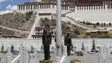 "Paramilitary policemen guard the Potala Palace in Lhasa, Tibet. The June visit by US Ambassador Gary Locke was used as an ""opportunity"" to replace them with uniformed police."