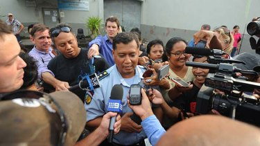 Attention: Kerobokan Prison governor Farid Junaidi addresses media gathered outside.
