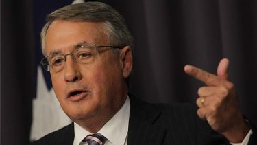 """""""What we've seen in this quarter has been a pretty savage reduction in our terms of trade"""" ... Treasurer Wayne Swan."""