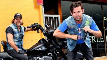 Phil Jamieson, pictured right with Big Day Out chief executive Adam Zammit,  looks quintessentially rock'n'roll. He sports dark sunglasses, chipped black nail polish and a cut-off denim vest.