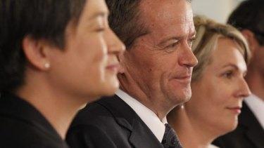 Power line: Penny Wong, Bill Shorten and Tanya Plibersek face the press at Parliament House.