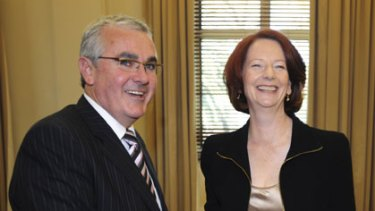Friend in need ... Prime Minister Julia Gillard greets Tasmanian independent MP Andrew Wilkie.
