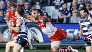AFL Round 23. Geelong  vs Sydney at Skilled Stadium.Swans captain Adam Goodes launches himself at Cats midfielder Joel Selwood.Melbourne. 20 August 2011.Picture by PAUL ROVERE / THE AGE