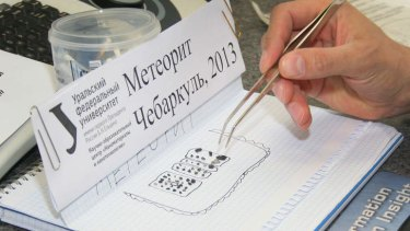 Pieces of porous black rock, reportedly fragments of the meteor that plunged over Russia's Ural Mountains.