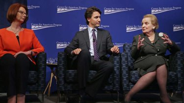 Former Australian Prime Minister Julia Gillard, Canadian Parliament Liberal Party member Justin Trudeau and former Secretary of State Madeleine Albright participate in a panel discussion during a conference in Washington.