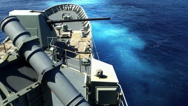 HMAS Warramunga, shown on exercise, struggled with a boat carrying more than 150 asylum seekers in 2001.