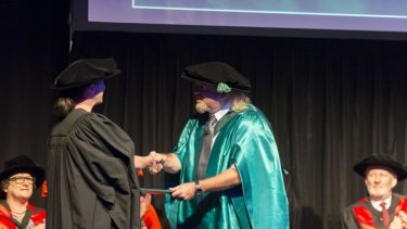 Comedian Bill Bailey receives an honorary doctorate from the University of the Sunshine Coast for his work in conservation and promoting scientific history.