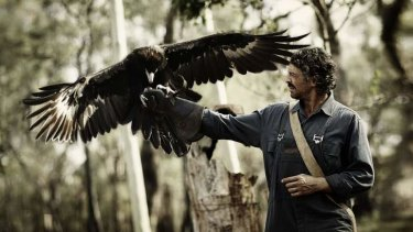 Actor Don Hany and wedge-tailed eagle Bart on the set of the movie <i>Healing</i>, being filmed at Kyneton.