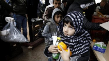 A child receiving food from the Orthodox Church of Greece, in Athens.