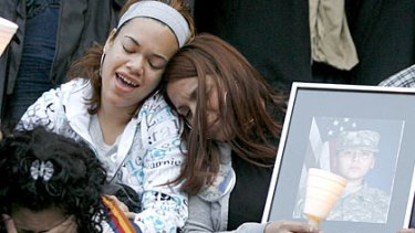 Family members listen to music during a vigil for US Pvt. Francheska Velez, 21, who was killed in the Fort Hood massacre.
