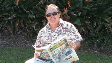 Proof? ... Peter Foster reading Fijian newspaper The Sunday Times.