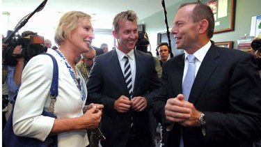 Lieutenant Colonel Cate McGregor, pictured with former cricketer Brett Lee and Prime Minister Tony Abbott, during the launch of the Prime Minister's XI late last year.